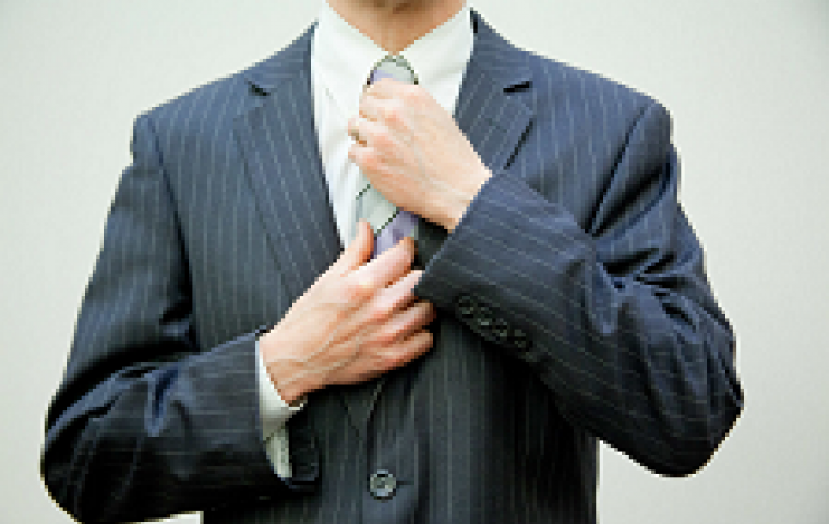 man adjusting tie to represent male ftse CEO flazingo_photos creative commons